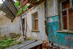 Wrecked room in an old abandoned house. The wrecked room in an old abandoned house Royalty Free Stock Photos