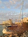 Wrecked Sailboat. On the rocks in Sarasota Bay Florida Royalty Free Stock Photos
