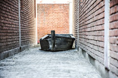 The wrecked ship. A wrecked ship in the  alleyway Royalty Free Stock Photos
