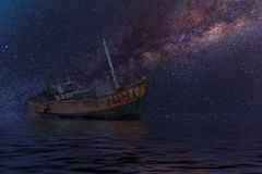 The wrecked ship under starry night with clearly  milky way.  Stock Photo