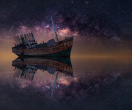 The wrecked ship under starry night with clearly  milky way Royalty Free Stock Photos