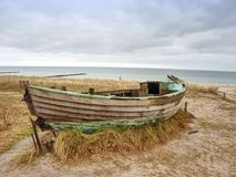 Free Wrecked Wooden Fisher Boat. Broken Abandoned Boat In Sand Of Sea Bay. Royalty Free Stock Photography - 110962427