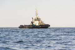 Wrecker boat on open sea royalty free stock photo