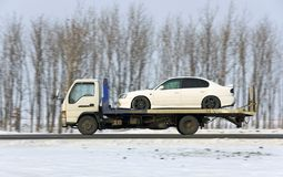 wrecker carries the car of white color Stock Photo