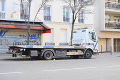 Wrecker on a parking in Paris Stock Image