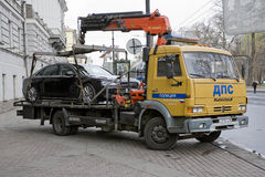 The wrecker removes incorrectly parked car. St. Petersburg, Russia - May 9: The wrecker takes away the car, broken parking rules in the city of St. Petersburg stock photography