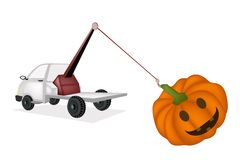 Wrecker Tow Truck Pulling A Jack-o-Lantern Pumpkins Royalty Free Stock Photography