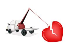 Wrecker Tow Truck Pulling A Red Broken Heart Stock Photos