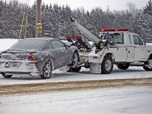Wrecker Towing A Car In Winter Stock Image
