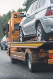 Wrecker transports broken car Stock Photos