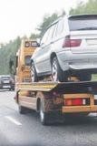 Wrecker transports broken car Royalty Free Stock Image