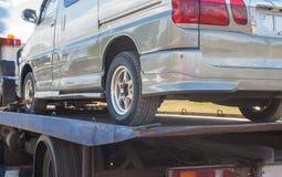 Wrecker transports broken miniveins Royalty Free Stock Photo