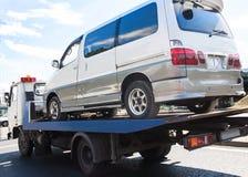 Wrecker transports broken miniveins Stock Image