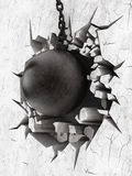 Wrecking ball demoslishes the wall Royalty Free Stock Image