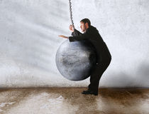 Wrecking ball win. Wrecking ball knock out the businessman Stock Image