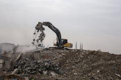 Wrecking crane on Debris Stock Images
