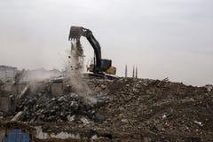 Wrecking crane on debris Royalty Free Stock Photos