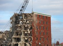 Wrecking of the Holiday Inn. Tearing down an old hotel with a wrecking ball Stock Photography