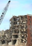 Wrecking of the Holiday Inn. Tearing down an old hotel with a wrecking ball Stock Image