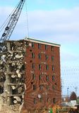 Wrecking of the Holiday Inn. Tearing down an old hotel with a wrecking ball Royalty Free Stock Photography