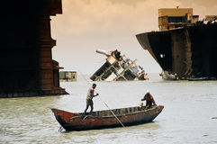 Among the wrecks, Bangladesh. Boat bringing the refreshment for workers on the Tanker Royalty Free Stock Photography