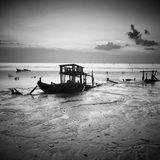 A wrecks old boat at beach. A wrecks old boat at beach in fine art monochrome Stock Photo