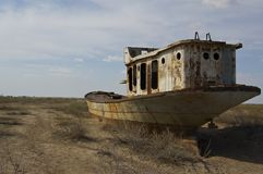 Wrecks of old boats in Aral lake. In Uzbekistan Royalty Free Stock Image