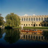 Wren Library Trinity College Cambridge. From The Backs the Wren Library Trinity College Cambridge with a punt in the foreground on the river Cam Royalty Free Stock Images