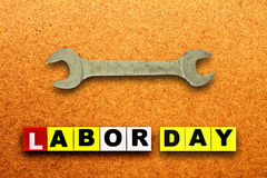 Wrench. Close up view of spanner on wood board,labor day royalty free stock images