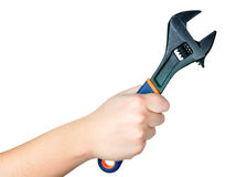 Wrench. Hand holding a British wrench on a white background Stock Image
