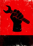 Wrench. Red and black poster with hand holds a wrench Royalty Free Stock Photography