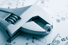Wrench And Nut Over Technical Drawing Stock Photo