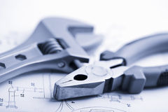 Wrench And Pliers Over Technical Drawing Stock Images