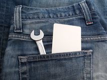 Wrench in the back jeans pocket Royalty Free Stock Photography