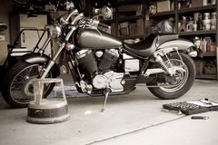 Wrench Bending. Motorcycle maintenance in a garage Stock Images