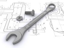 Wrench, bolt and nut against engineering drawings Royalty Free Stock Image