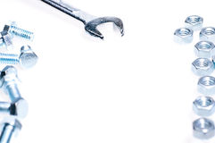 Wrench with bolts and nuts Stock Images