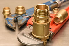 Wrench and brass fittings Royalty Free Stock Image