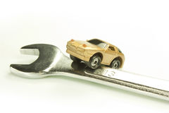 Wrench and car Stock Photography
