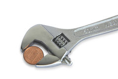 Wrench and coin Stock Photos