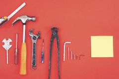 Wrench engineer constructor tools on a denim workers, A red background with engineer constructor tools. Several engineer construct. Or tools on a denim workers royalty free stock photo