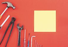 Wrench engineer constructor tools on a denim workers, A red background with engineer constructor tools. Several engineer construct. Or tools on a denim workers stock photos