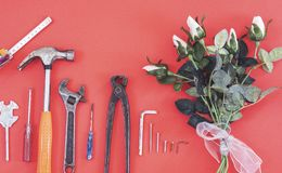 Wrench engineer constructor tools on a denim workers, A red background with engineer constructor tools. Several engineer construct. Or tools on a denim workers royalty free stock photography
