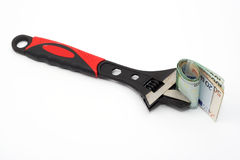 Wrench and euro bills Royalty Free Stock Photography