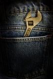 Wrench and fabric jeans Royalty Free Stock Photo