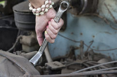 Wrench In Female Hands Stock Photo