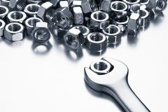 Wrench with nuts stock photos