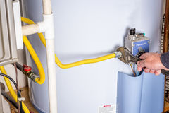 Wrench on a gas line for a hot water heater Stock Image