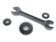 Wrench and gear wheels Stock Photos