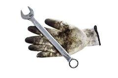 Wrench and a glove Stock Photos